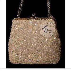 La Regale cream beaded elegant purse